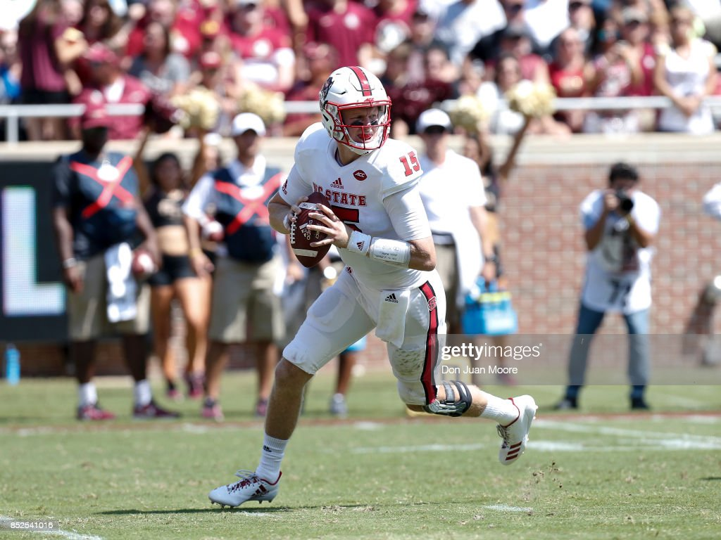 Quarterback Ryan Finley #15 of the North Carolina State Wolfpack on a pass play during the game against the Florida State Seminoles at Doak Campbell Stadium on Bobby Bowden Field on September 23, 2017 in Tallahassee, Florida. NC State defeated Florida State 27 to 21.