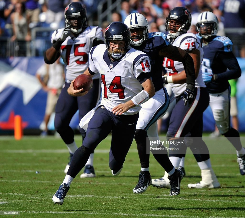 Quarterback Ryan Fitzpatrick #14 of the Houston Texans scrambles against the Tennessee Titans at LP Field on October 26, 2014 in Nashville, Tennessee.
