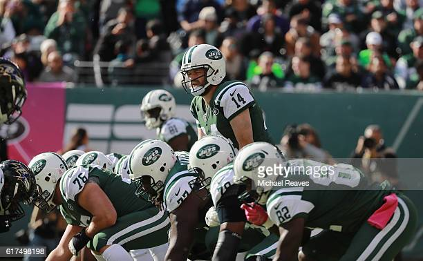 Quarterback Ryan Fitzpatrick of the New York Jets calls a play against the Baltimore Ravens during the first half at MetLife Stadium on October 23...