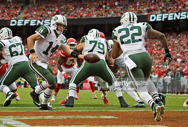 Quarterback Ryan Fitzpatrick of the New York Jets hands the ball off to running back Matt Forte against the Kansas City Chiefs during the first half...