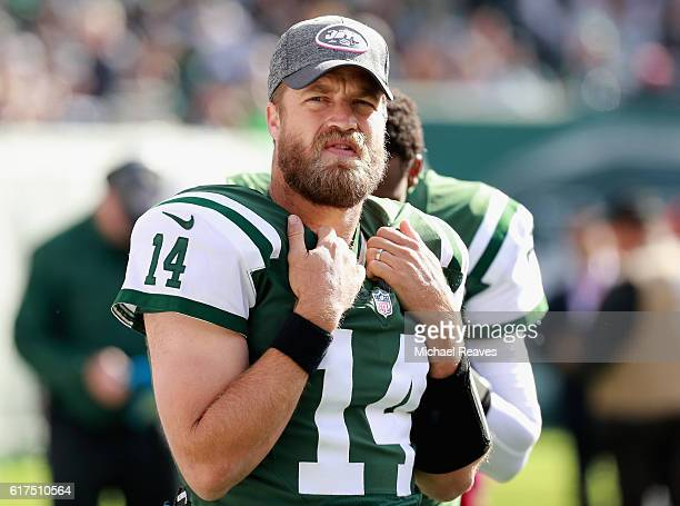 Quarterback Ryan Fitzpatrick of the New York Jets looks on in the first half against the Baltimore Ravens at MetLife Stadium on October 23 2016 in...