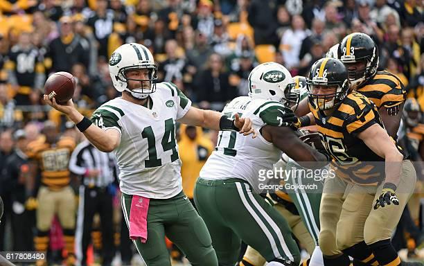 Quarterback Ryan Fitzpatrick of the New York Jets passes as tackle Ben Ijalana blocks against linebacker Anthony Chickillo and defensive lineman...