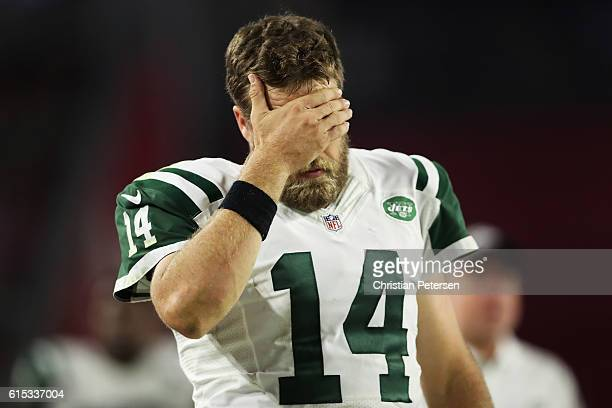 Quarterback Ryan Fitzpatrick of the New York Jets reacts in the second half of the NFL game against the Arizona Cardinals at the University of...