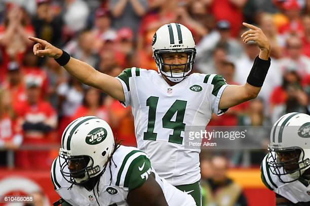 Quarterback Ryan Fitzpatrick of the New York Jets signals an audible against the Kansas City Chiefs defense at Arrowhead Stadium during the first...