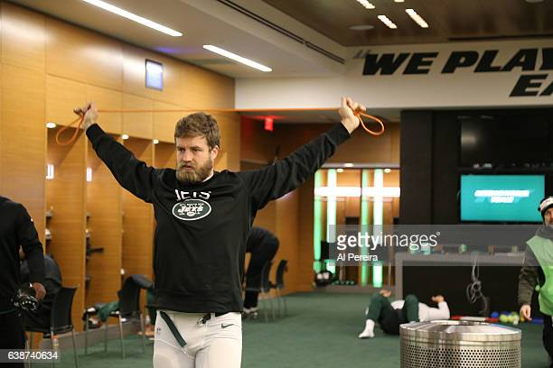 Quarterback Ryan Fitzpatrick of the New York Jets stretches in the locker room before the game against the Buffalo Bills at MetLife Stadium on...
