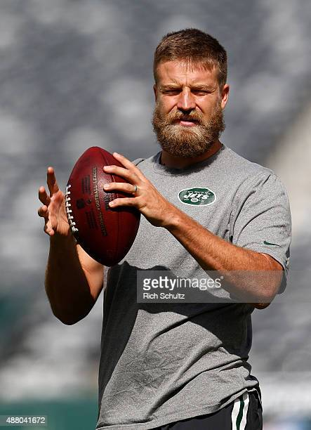 Quarterback Ryan Fitzpatrick of the New York Jets warms up before a game against the Cleveland Browns at MetLife Stadium on September 13 2015 in East...