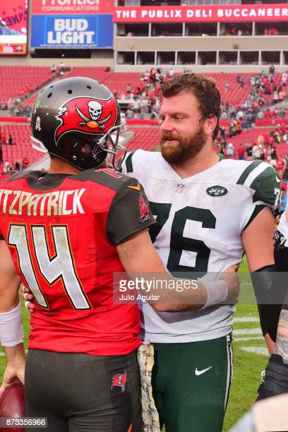 Quarterback Ryan Fitzpatrick of the Tampa Bay Buccaneers and center Wesley Johnson of the New York Jets share some friendly words following the Tampa...