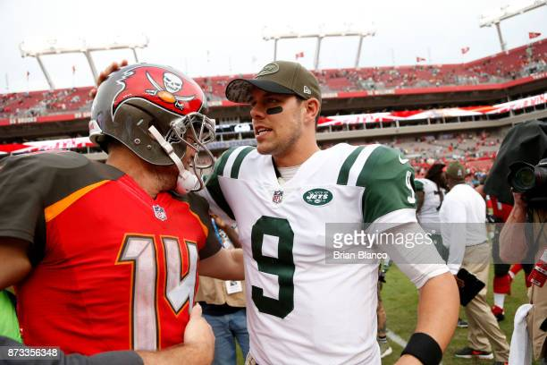 Quarterback Ryan Fitzpatrick of the Tampa Bay Buccaneers hugs quarterback Bryce Petty of the New York Jets following the Buccaneers' 1510 win over...