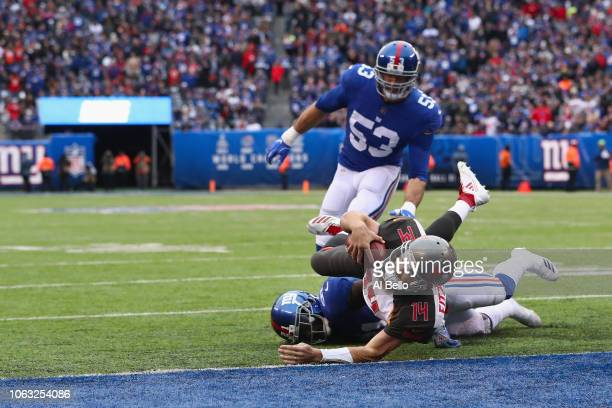 Quarterback Ryan Fitzpatrick of the Tampa Bay Buccaneers makes a touchdown against safety Landon Collins of the New York Giants in the second quarter...