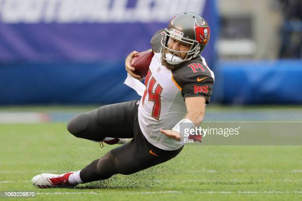 Quarterback Ryan Fitzpatrick of the Tampa Bay Buccaneers scrambles against the New York Giants in the first quarter at MetLife Stadium on November 18...