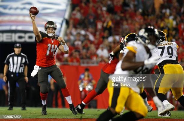 Quarterback Ryan Fitzpatrick of the Tampa Bay Buccaneers throws to an open receiver during the first quarter of a game against the Pittsburgh...