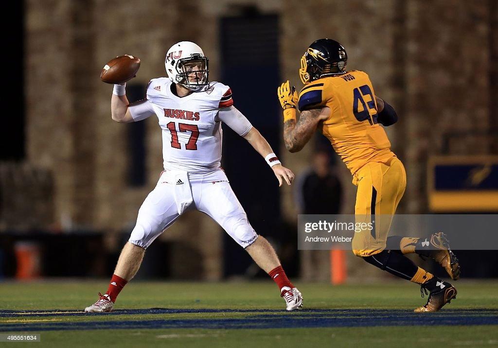 Quarterback Ryan Graham #17 of the Northern Illinois Huskies looks to pass while being pressured by defensive end Trent Voss #43 of the Toledo Rockets during the third quarter at Glass Bowl on November 3, 2015 in Toledo, Ohio. Northern Illinois Huskies defeated Toledo Rockets 32-27.