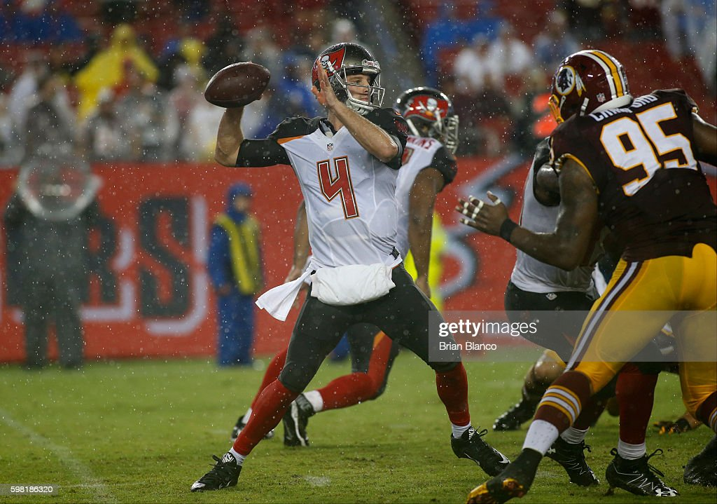 Quarterback Ryan Griffin #4 of the Tampa Bay Buccaneers gets pressure from defensive end Corey Crawford #95 of the Washington Redskins during the second quarter of an NFL game on August 31, 2016 at Raymond James Stadium in Tampa, Florida.