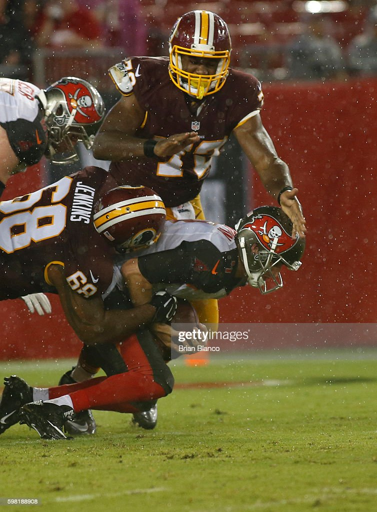 Quarterback Ryan Griffin #4 of the Tampa Bay Buccaneers is sacked by defensive lineman Cullen Jenkins #68 of the Washington Redskins during the second quarter of an NFL game on August 31, 2016 at Raymond James Stadium in Tampa, Florida.
