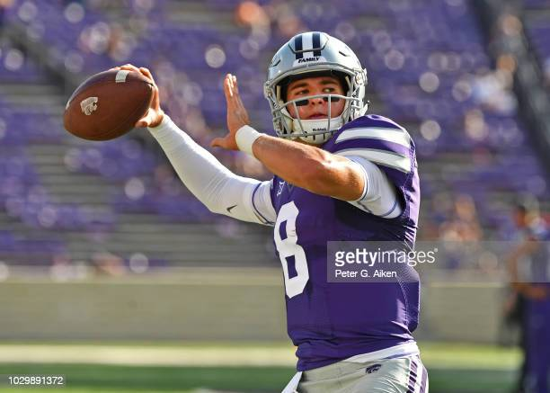 Quarterback Ryan Henington of the Kansas State Wildcats throws a pass during pre-game warm ups, prior to a game against the South Dakota Coyotes on...