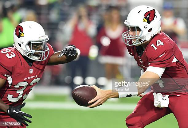 Quarterback Ryan Lindley of the Arizona Cardinals hands off the football to running back Kerwynn Williams in the first quarter of the NFL game...