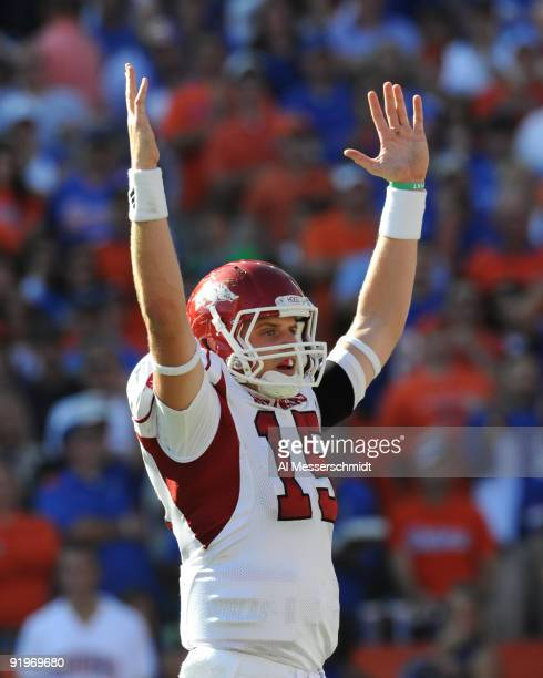 Quarterback Ryan Mallett of the Arkansas Razorbacks signals a touchdown against the Florida Gators October 17 2009 at Ben Hill Griffin Stadium in...