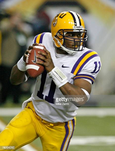 Quarterback Ryan Perrilloux of the LSU Tigers rolls out and looks downfield during the SEC Championship game against the Tennessee Volunteers at the...