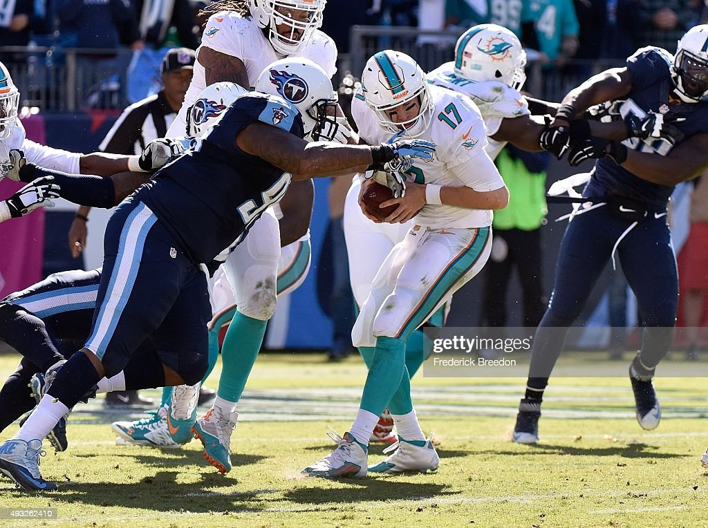 Quarterback Ryan Tannehill #17 of the Miami Dolphins is sacked by the Tennessee Titans during the first half of a game at Nissan Stadium on October 18, 2015 in Nashville, Tennessee.