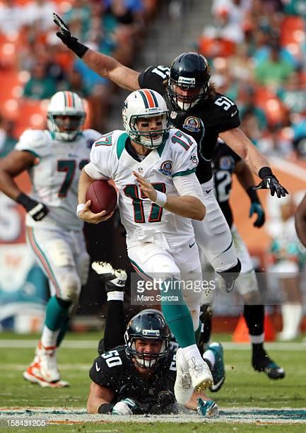 Quarterback Ryan Tannehill of the Miami Dolphins scrambles against the Jacksonville Jaguars at Sun Life Stadium on December 16 2012 in Miami Gardens...