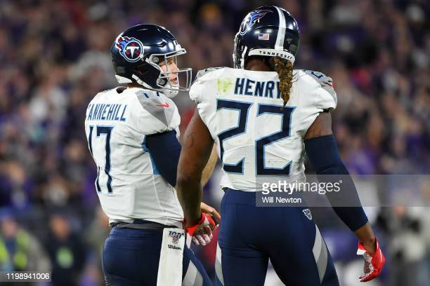 Quarterback Ryan Tannehill of the Tennessee Titans and Derrick Henry talk on the field during the AFC Divisional Playoff game against the Baltimore...