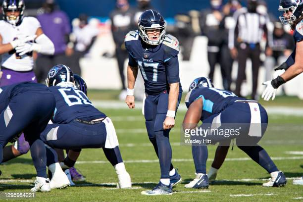 Quarterback Ryan Tannehill of the Tennessee Titans calls the play at the line of scrimmage during their AFC Wild Card Playoff game against the...