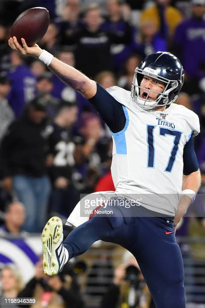 Quarterback Ryan Tannehill of the Tennessee Titans celebrates after rushing for a touchdown in the third quarter of the AFC Divisional Playoff game...