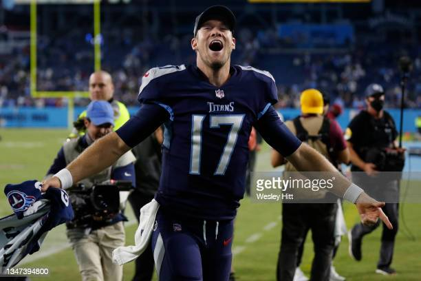 Quarterback Ryan Tannehill of the Tennessee Titans celebrates after defeating the Buffalo Bills at Nissan Stadium on October 18, 2021 in Nashville,...