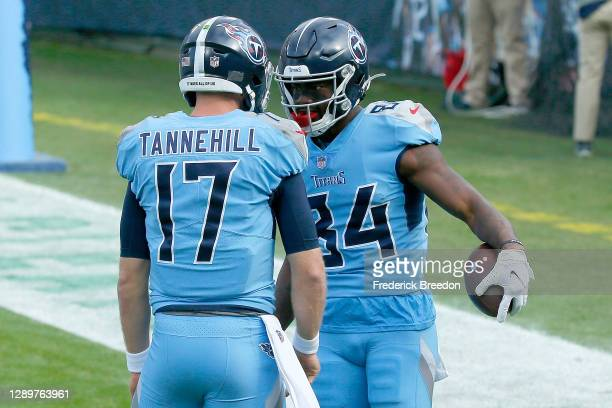 Quarterback Ryan Tannehill of the Tennessee Titans celebrates with wide receiver Corey Davis after his touchdown catch against the Cleveland Browns...