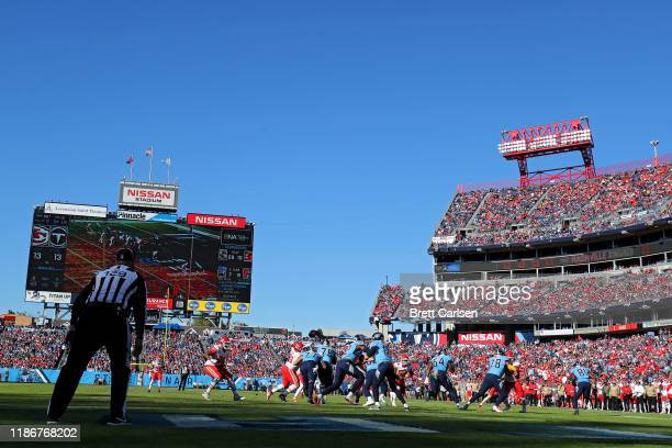 Quarterback Ryan Tannehill of the Tennessee Titans hands off to running back Derrick Henry of the Tennessee Titans against the Kansas City Chiefs in...