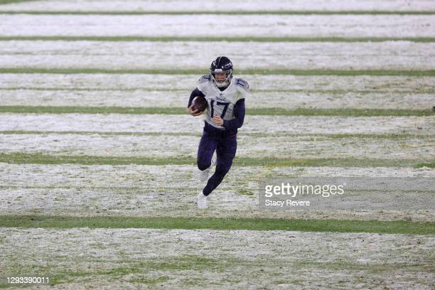 Quarterback Ryan Tannehill of the Tennessee Titans runs for 49-yard touchdown against the Green Bay Packers during the third quarter at Lambeau Field...