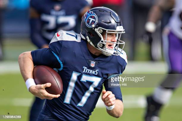 Quarterback Ryan Tannehill of the Tennessee Titans runs the ball during their AFC Wild Card Playoff game against the Baltimore Ravens at Nissan...
