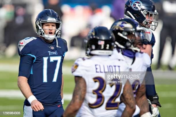 Quarterback Ryan Tannehill of the Tennessee Titans talks with the defense during their AFC Wild Card Playoff game against the Baltimore Ravens at...