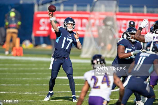 Quarterback Ryan Tannehill of the Tennessee Titans throws a pass during their AFC Wild Card Playoff game against the Baltimore Ravens at Nissan...