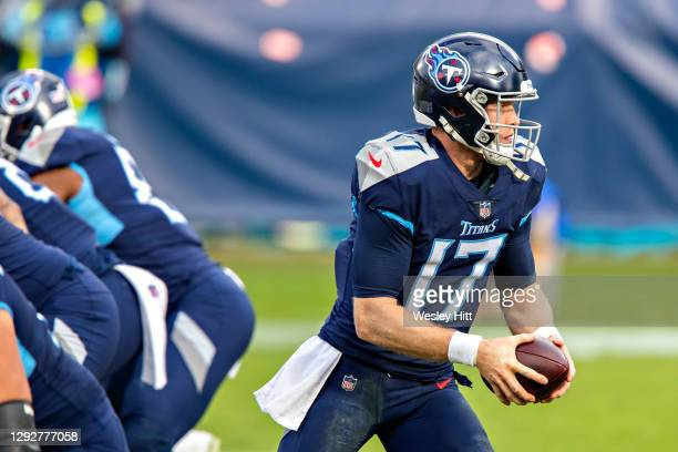 Quarterback Ryan Tannehill of the Tennessee Titans turns to make a hand off during a game against the Detroit Lions at Nissan Stadium on December 20,...