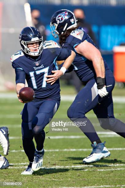 Quarterback Ryan Tannehill of the Tennessee Titans turns to make a hand off during their AFC Wild Card Playoff game against the Baltimore Ravens at...