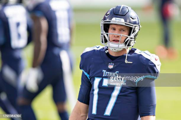 Quarterback Ryan Tannehill of the Tennessee Titans warms up before their AFC Wild Card Playoff game against the Baltimore Ravens at Nissan Stadium on...