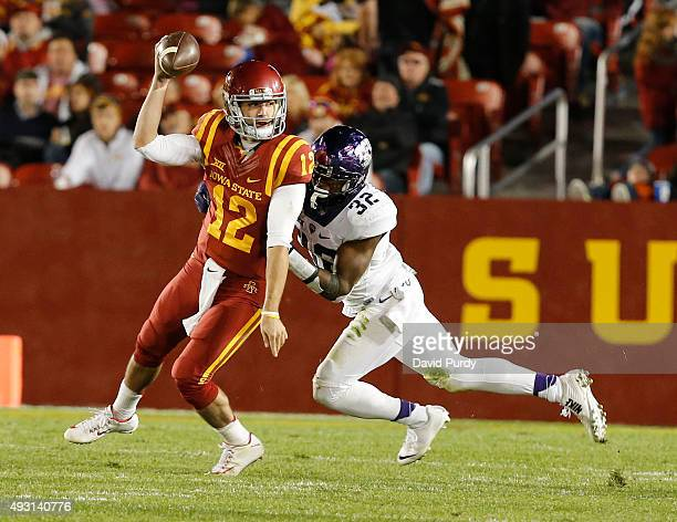 Quarterback Sam B Richardson of the Iowa State Cyclones is sacked by safety Travin Howard of the TCU Horned Frogs in the first half of play at Jack...