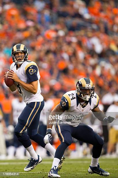 Quarterback Sam Bradford and running back Isaiah Pead of the St Louis Rams in action against the Denver Broncos at Sports Authority Field at Mile...