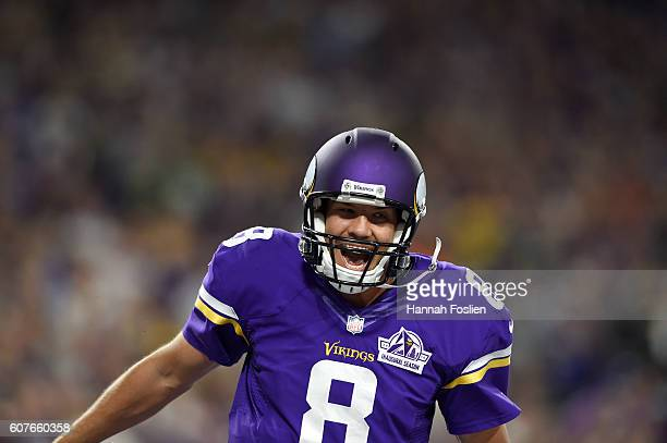 Quarterback Sam Bradford of the Minnesota Vikings celebrates after completing a touchdown pass in the third quarter of the game against the Green Bay...