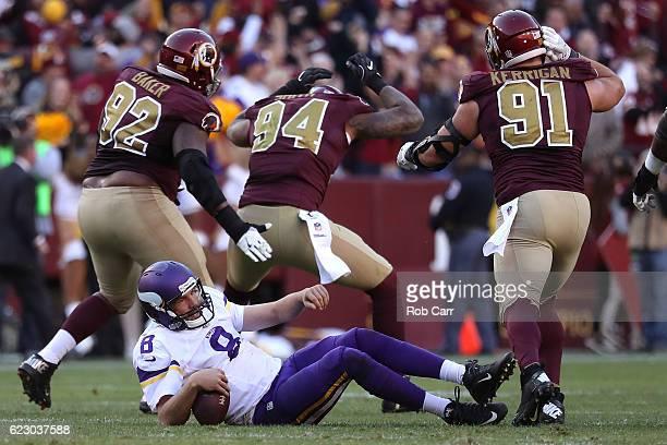 Quarterback Sam Bradford of the Minnesota Vikings is sacked by outside linebacker Preston Smith of the Washington Redskins in the fourth quarter at...