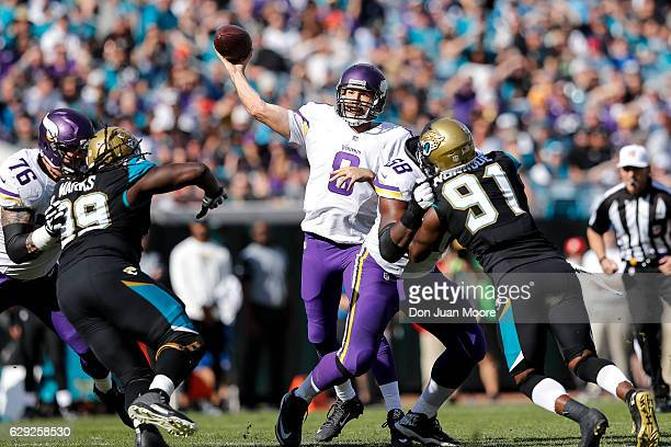 Quarterback Sam Bradford of the Minnesota Vikings on a pass play protected by Guard Alex Boone and Tackle TJ Clemmings from Sen'Derrick Marks and...