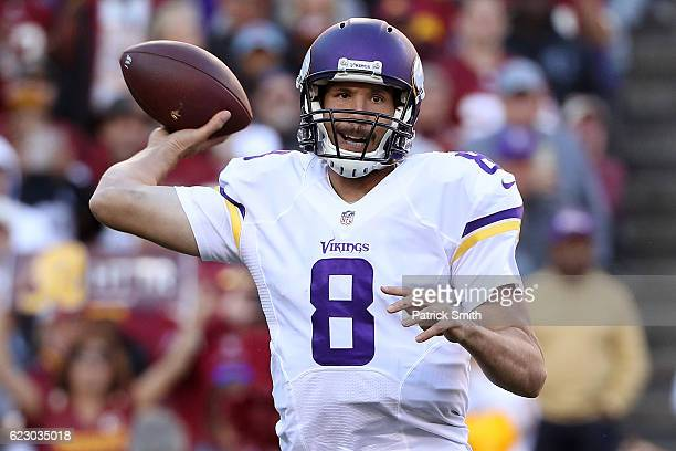 Quarterback Sam Bradford of the Minnesota Vikings passes the ball against the Washington Redskins in the fourth quarter at FedExField on November 13...