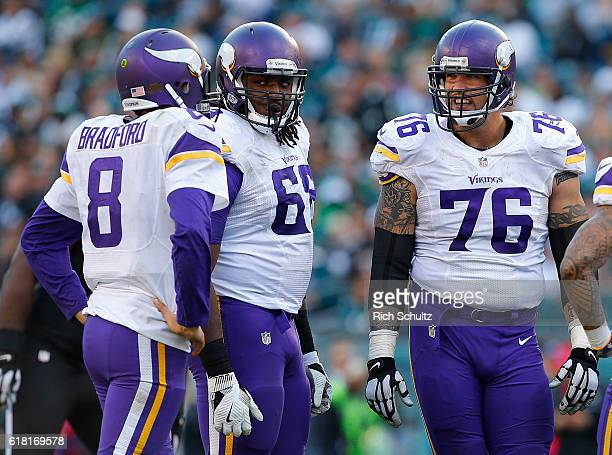 Quarterback Sam Bradford of the Minnesota Vikings talks with TJ Clemmings and Alex Boone during the fourth quarter of a game against the Philadelphia...
