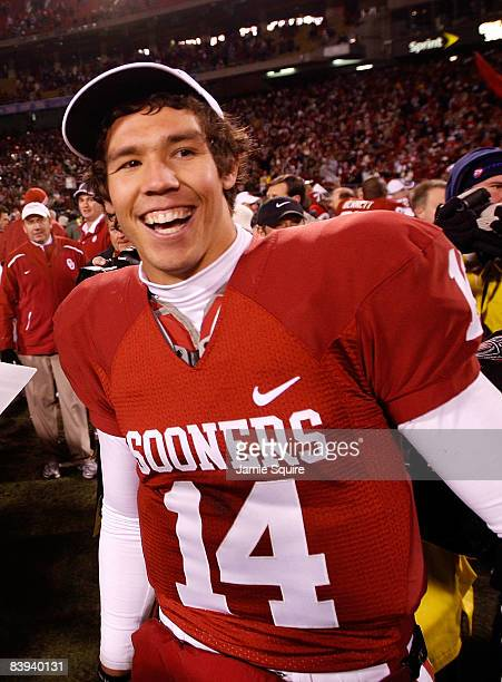 Quarterback Sam Bradford of the Oklahoma Sooners celebrates after the Sooners defeated the Missouri Tigers to win the Big 12 Championship game on...