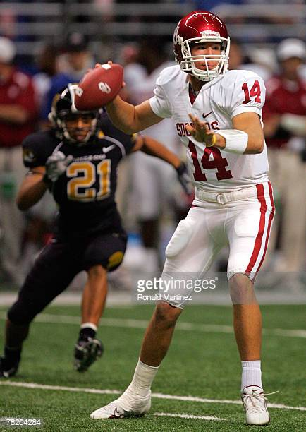 Quarterback Sam Bradford of the Oklahoma Sooners drops back to pass in the first quartar against the Missouri Tigers during the Big 12 Championship...