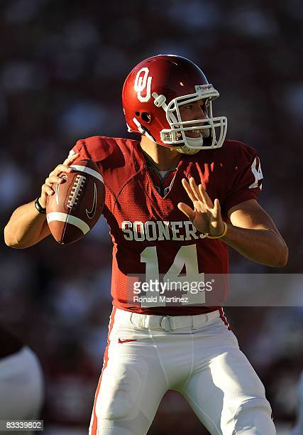 Quarterback Sam Bradford of the Oklahoma Sooners drops back to pass against the Kansas Jayhawks at Memorial Stadium on October 18 2008 in Norman...