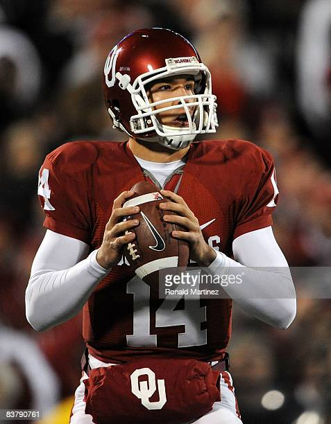 Quarterback Sam Bradford of the Oklahoma Sooners drops back to pass against the Texas Tech Red Raiders at Memorial Stadium on November 22, 2008 in...