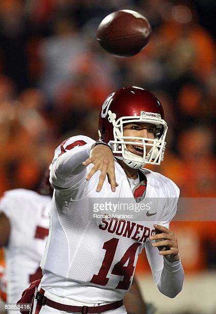 Quarterback Sam Bradford of the Oklahoma Sooners drops back to pass against the Oklahoma State Cowboys at Boone Pickens Stadium on November 29, 2008...