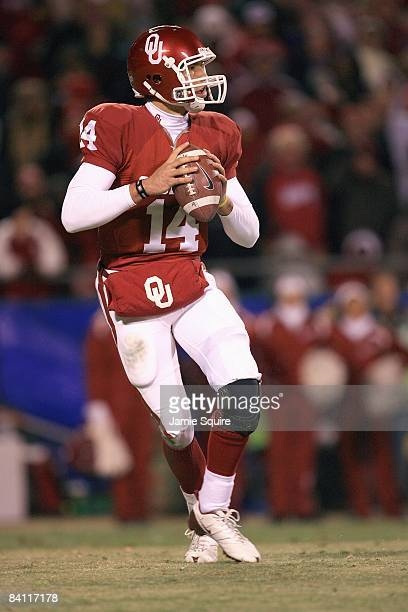 Quarterback Sam Bradford of the Oklahoma Sooners drops back to pass the ball during the Big 12 Championship game against the Missouri Tigers on...